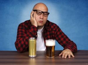 bald man drinking