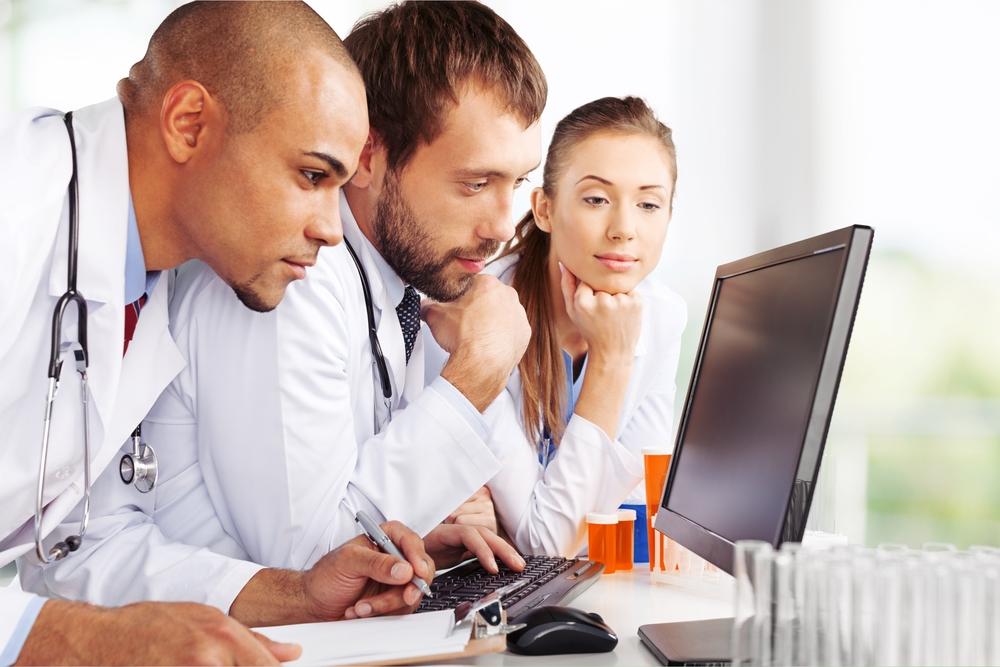 3 Doctors looking at a computer quizically