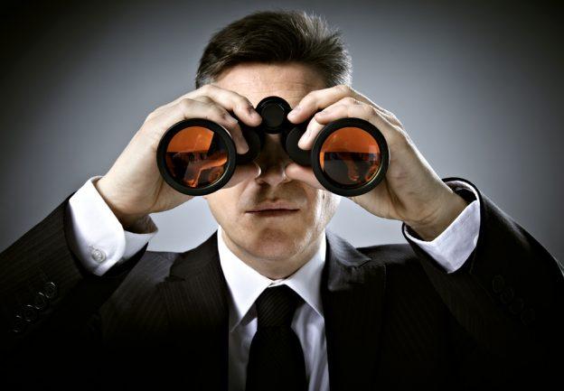 Man in suit with binoculars