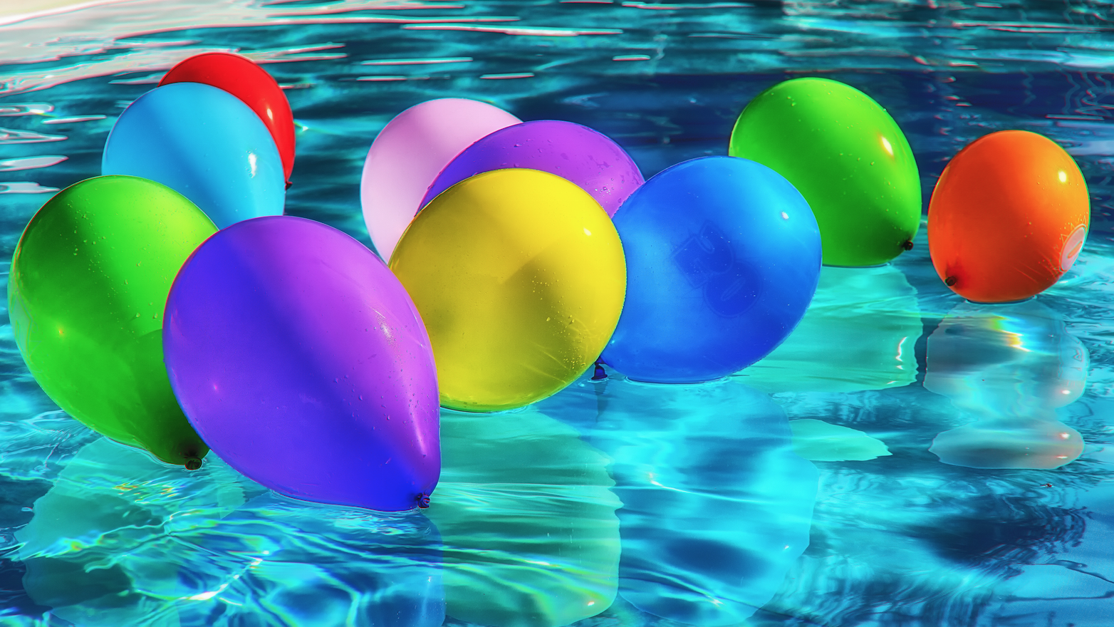 balloons floating on water