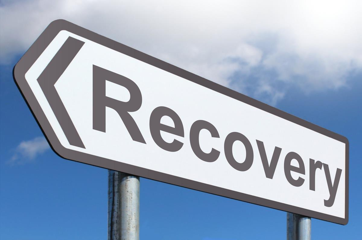 Road sign with the words Recovery on it
