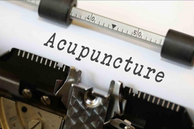 Acupuncture spelt out on typewriter
