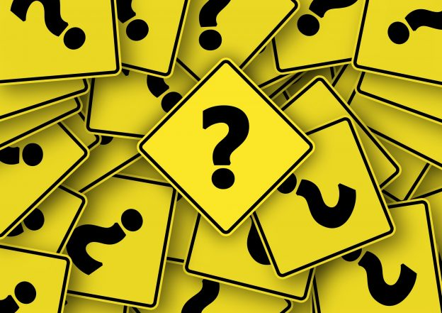 Yellow squares with black question marks