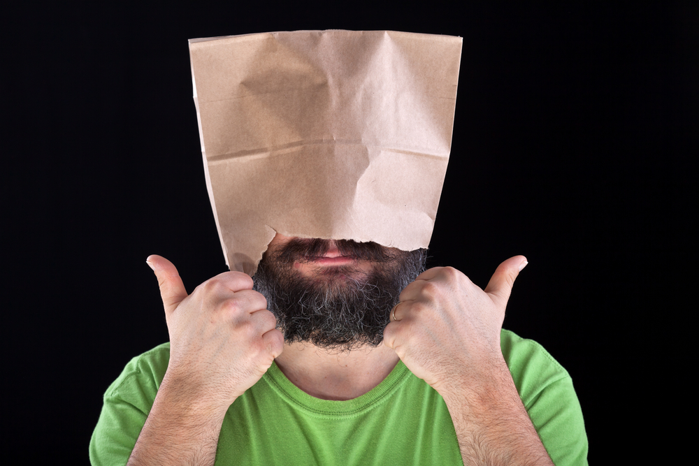 Man with paper bag over his head - thumbs up