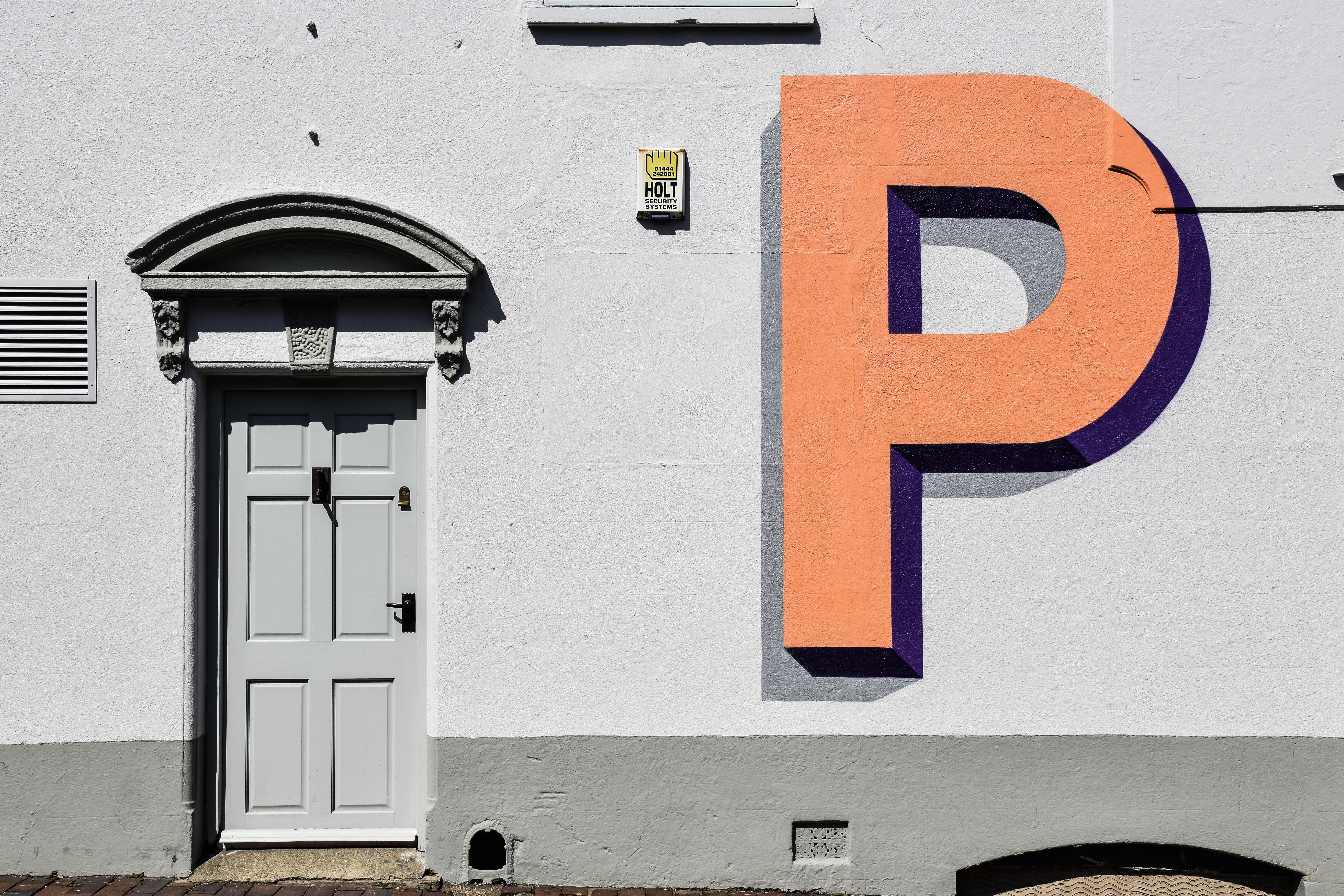 Letter P on a wall next to a door