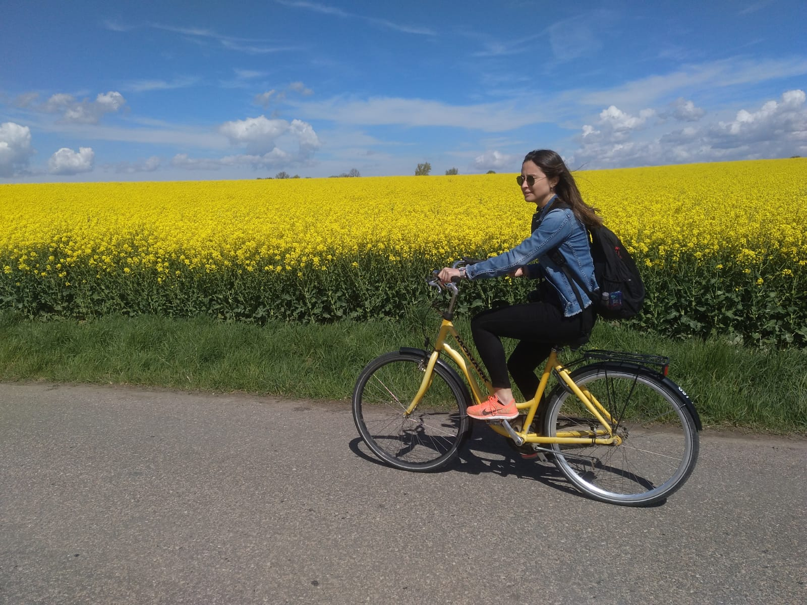 Chiara Nava riding bike in fields