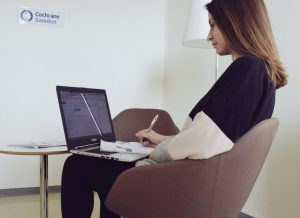 Chiara sitting at her laptop in Cochrane Sweden office